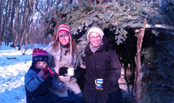 Enjoying hot chocolate after a busy time shelter building.