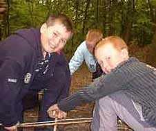 Boys Bow Drilling To Make Fire
